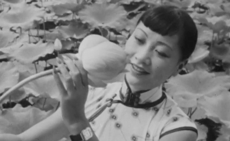 Anna May Wong holding a lotus flower